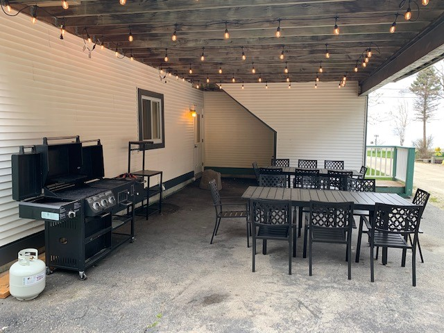 Grilling Station and outside eating area overlooking the water just off the 1st floor kitchen!