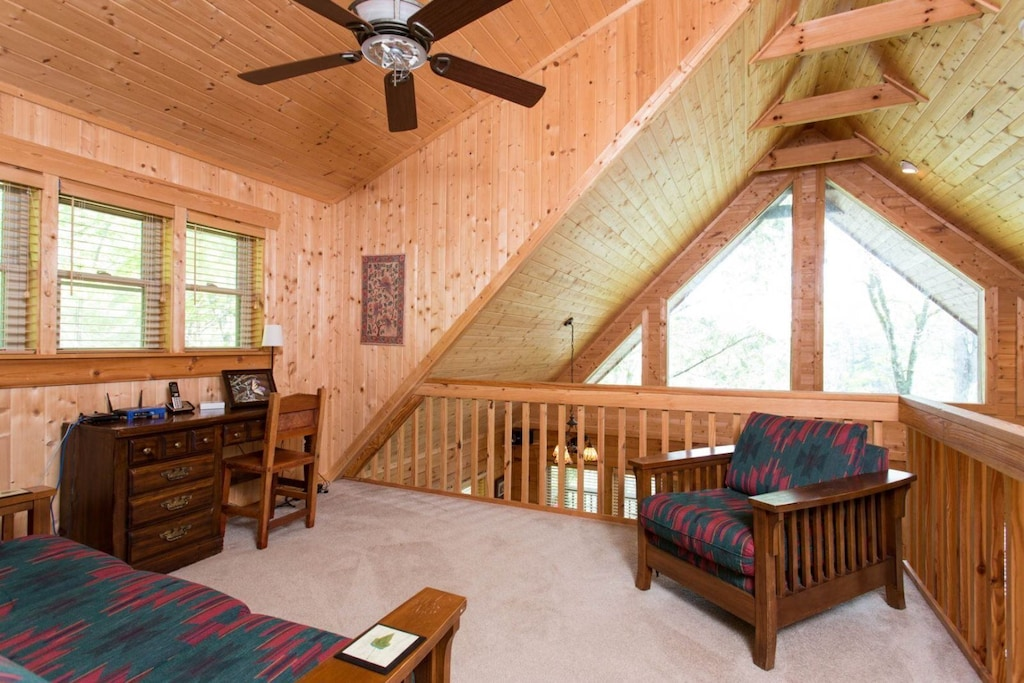 Head up to the loft and there is cozy furniture as well as a desk and chair.
