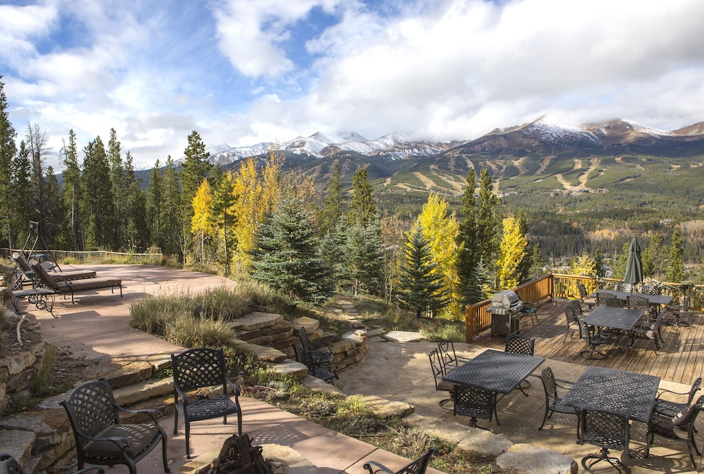 Upper and lower patios and deck with sunset mountain view - More private patio and aspens