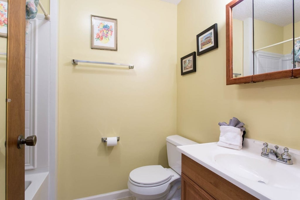 There is a full bath on this level with a single vanity and bathtub/shower combination.