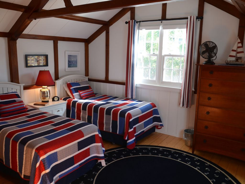 Spacious twin bedroom with closet and plenty of space in the bureaus.