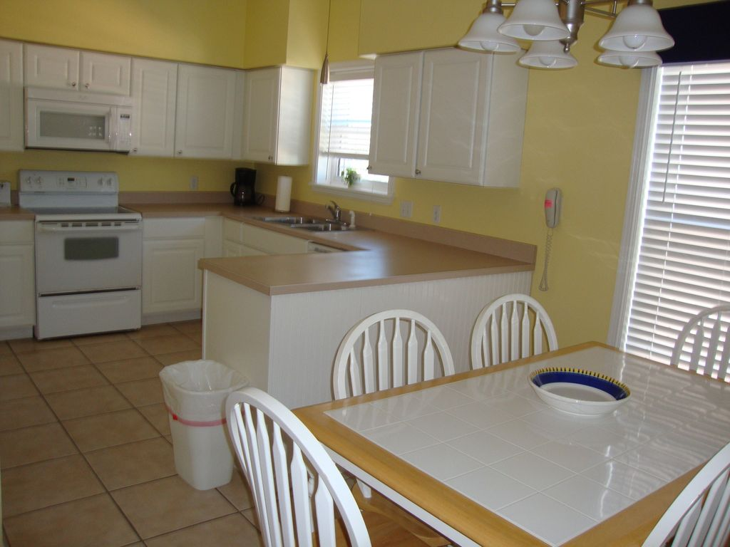One of Two Identical FULL Kitchen/Dining Areas