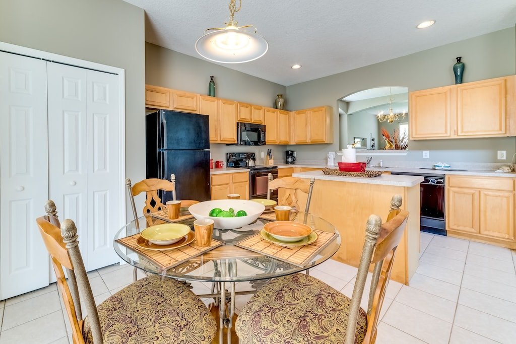 Large open kitchen with pots and pans