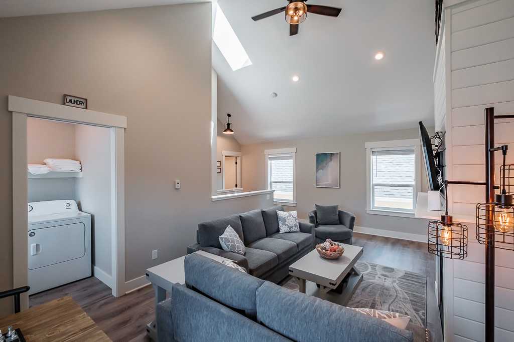Upstairs den with TV, high ceilings, and seating for 10..