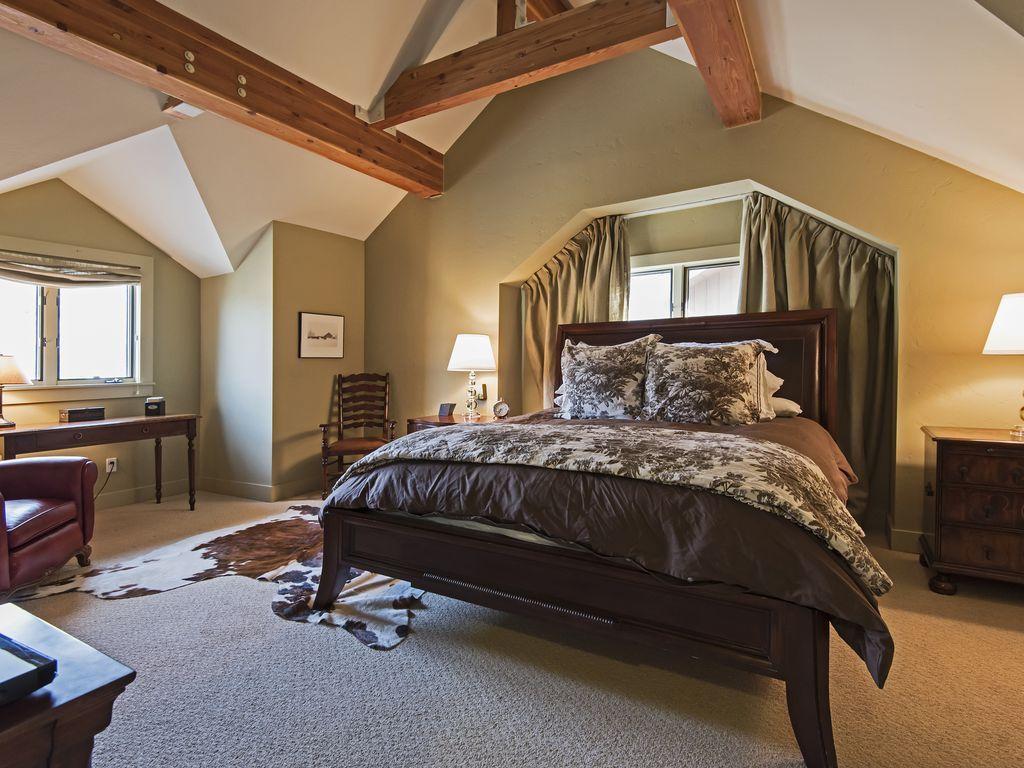 Master bedroom.  King size bed, TV, desk, views.