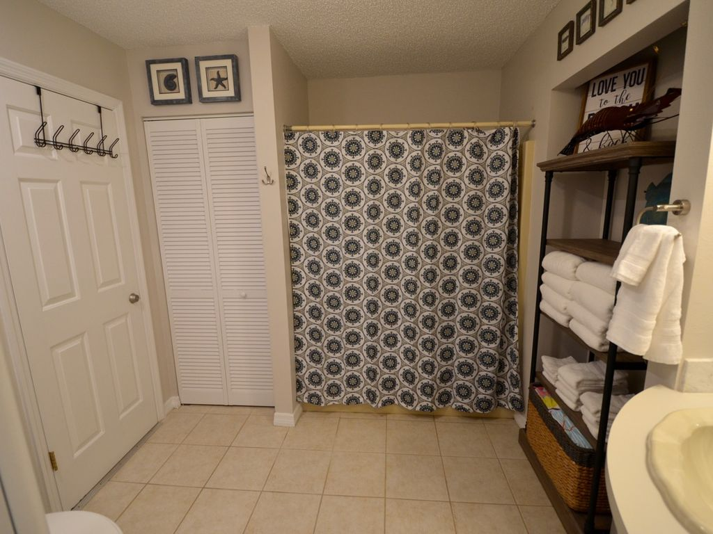 Downstairs bath with tub/shower combo. Closet for clothing or beach toys.