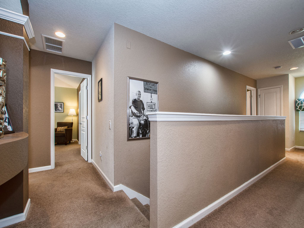 Upstairs hallway has access to 5 bedrooms.