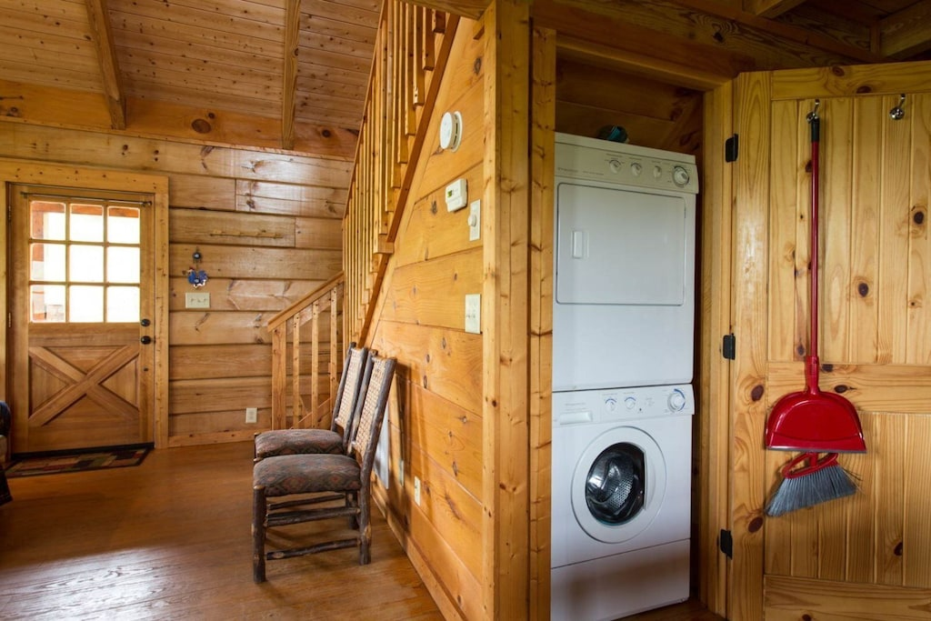 The stacked washer/dryer are behind a door in the kitchen area.
