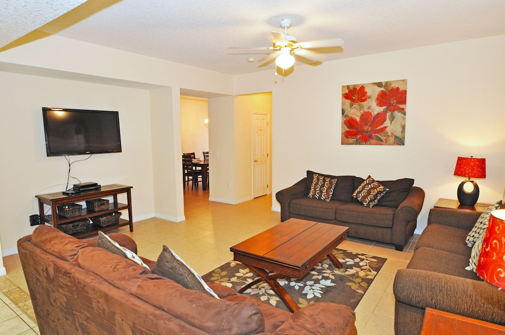 Large family room with 52'' TV.