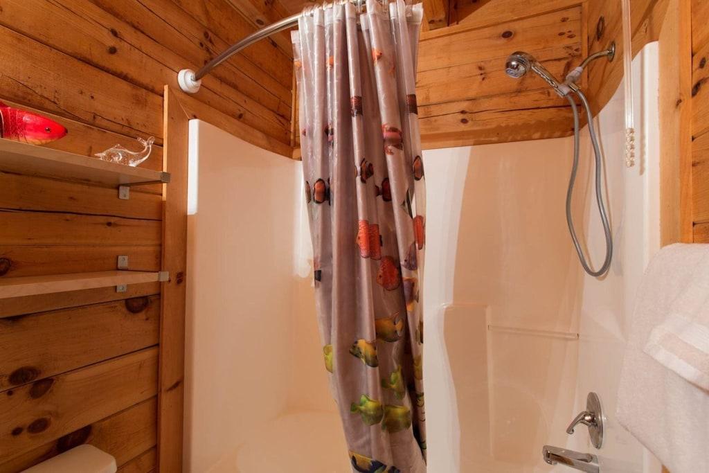 The bathroom has a bathtub/shower combination.