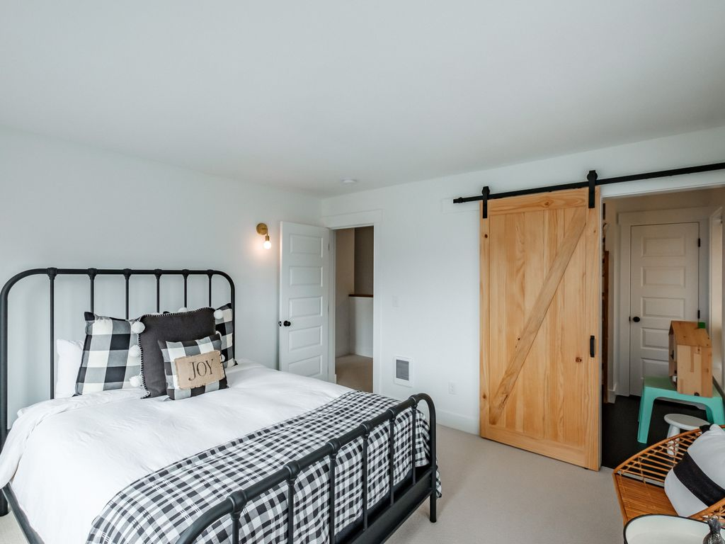 Sliding barn door adjoins the 4th bedroom and bunk room.