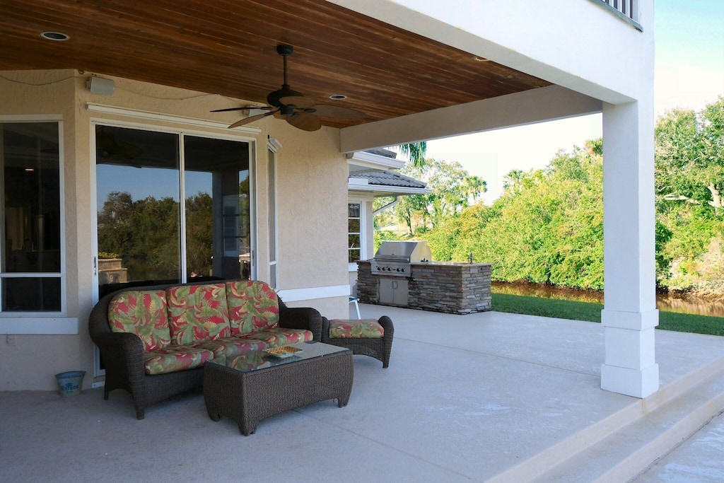 Large covered porch area between grill, pool and point - hang out outside even on rainy days!
