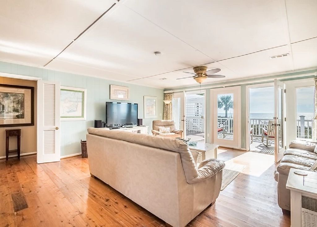 Open family room with large screen tv and views of the ocean!