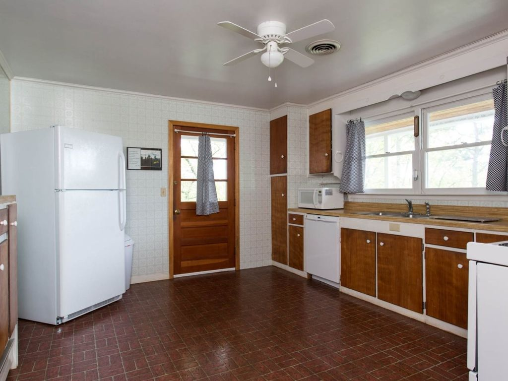 The kitchen is fully equipped, including a dishwasher