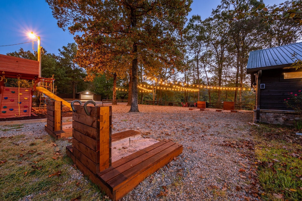 Horseshoe pits, fire pit with seating, and a play set for the kiddos.