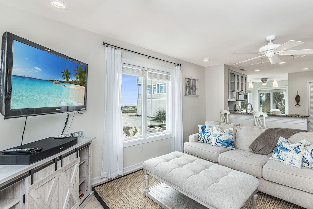 Living room open to kitchen with beach views