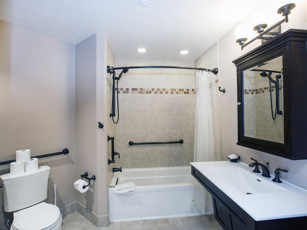 Master bath for Bedroom #1 - Private bath bedroom #1. Tub/shower ADA accessible, curved shower rod.