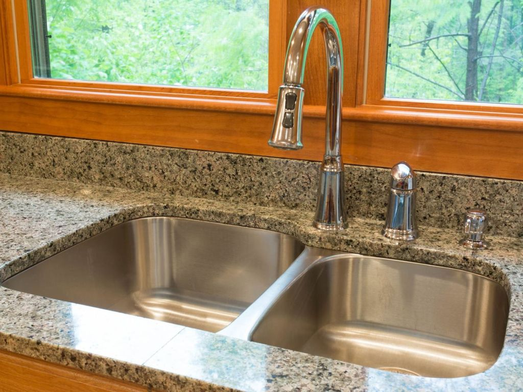There are high-end finishes and fixtures throughout the home, including the stylish kitchen sink faucet.