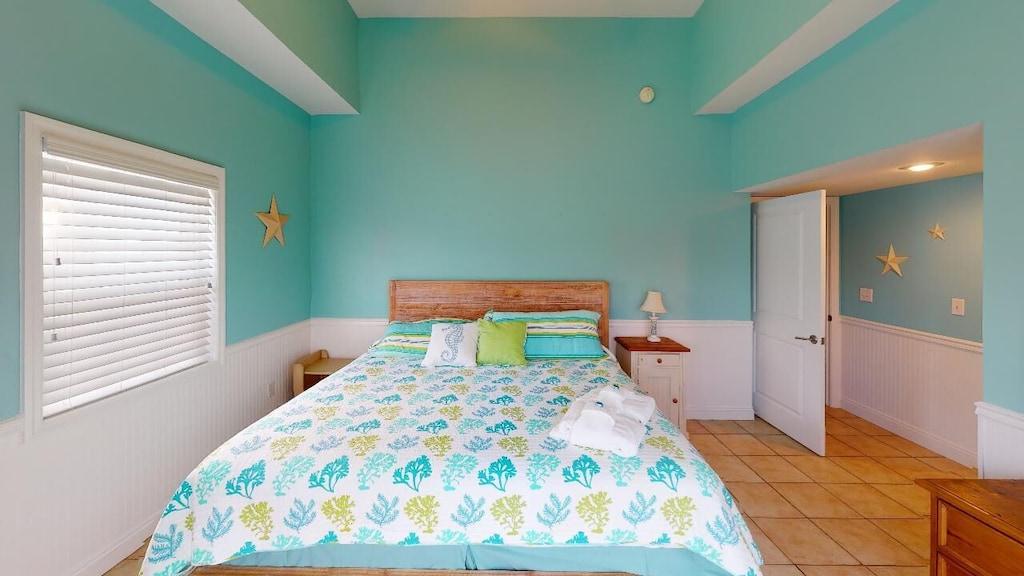 Ground floor bedroom with king bed