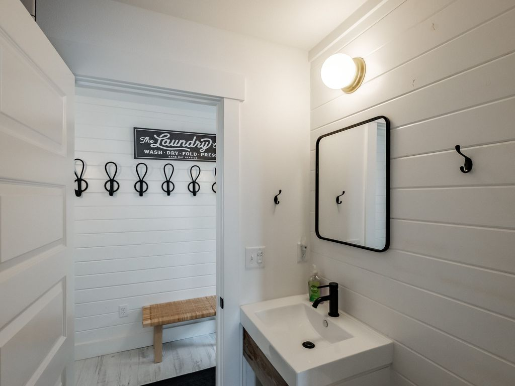 Lower level entry jack and jill master suite offers convenience and a beautifully tiled shower.