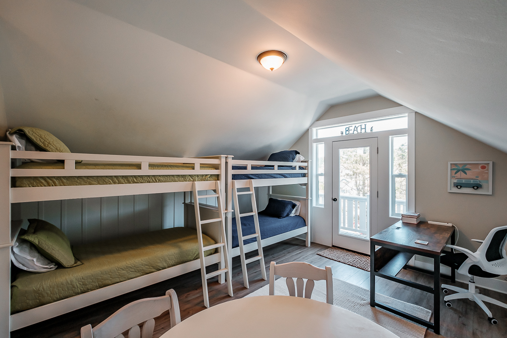 Upper level double bunk room with park side desk and balcony.
