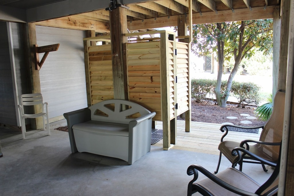 Enclosed outside shower!  Perfect way to wash away the sand!