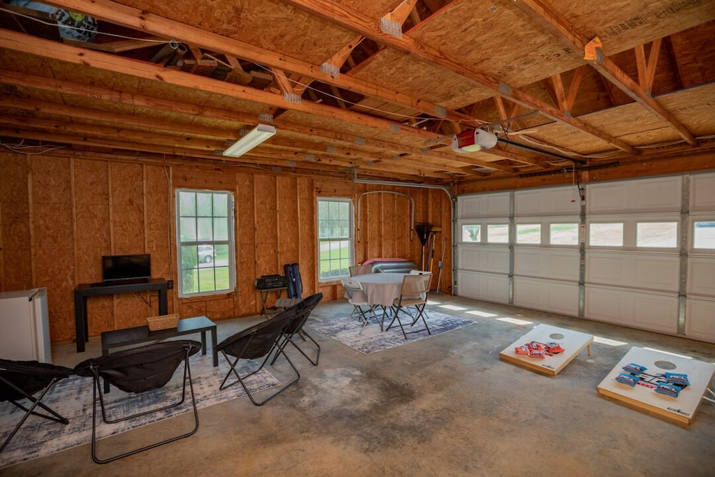 Additional recreational space in the garage-TV, seating, game table, beverage