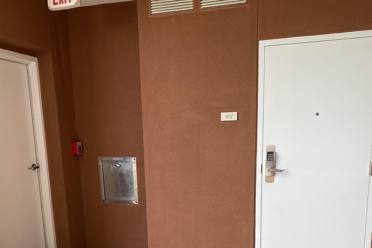 Condo entrance, next to trash chute