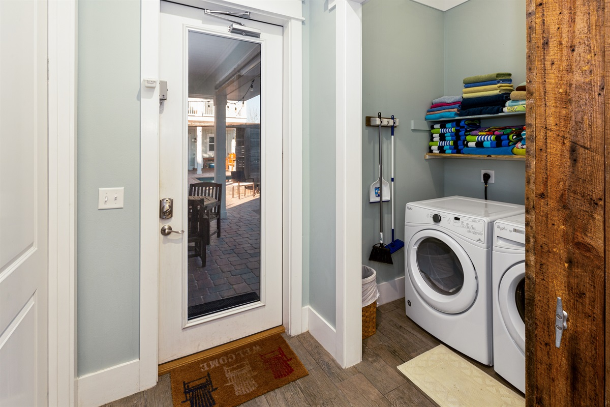 One of two full laundry rooms in the home, this one with custom built reclaimed barn wood. Beach towels provided for guest use.