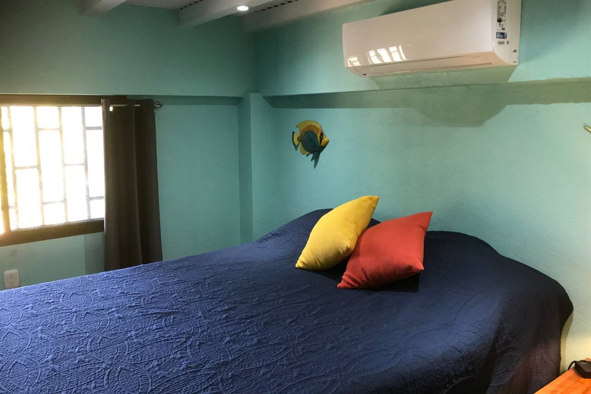 This is our second bedroom, queen bed over looking the pool