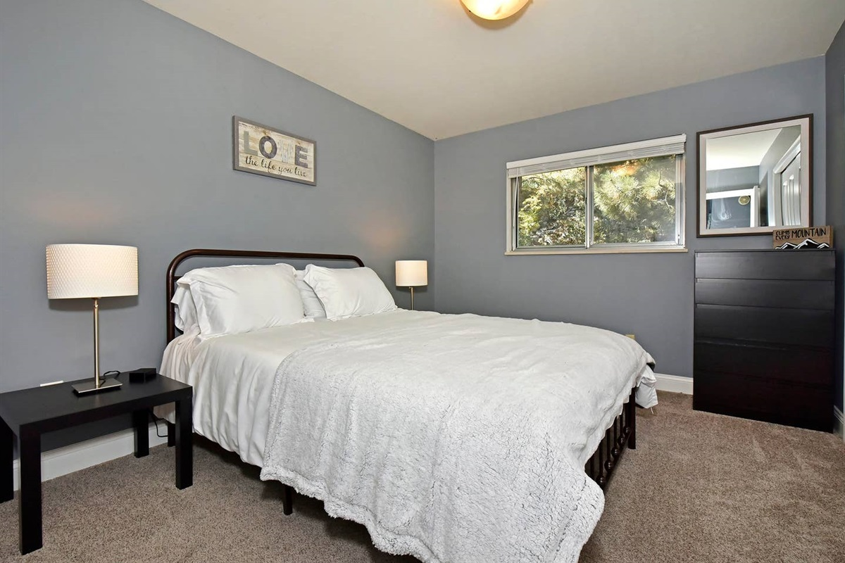 This second bedroom has a queen bed. Perfect for another couple or a young person!