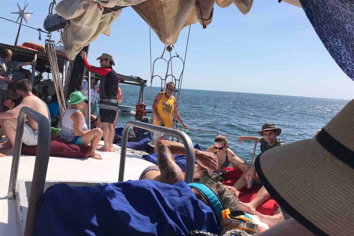Lounging on the beanbags up on deck as we make our way to the snorkel point