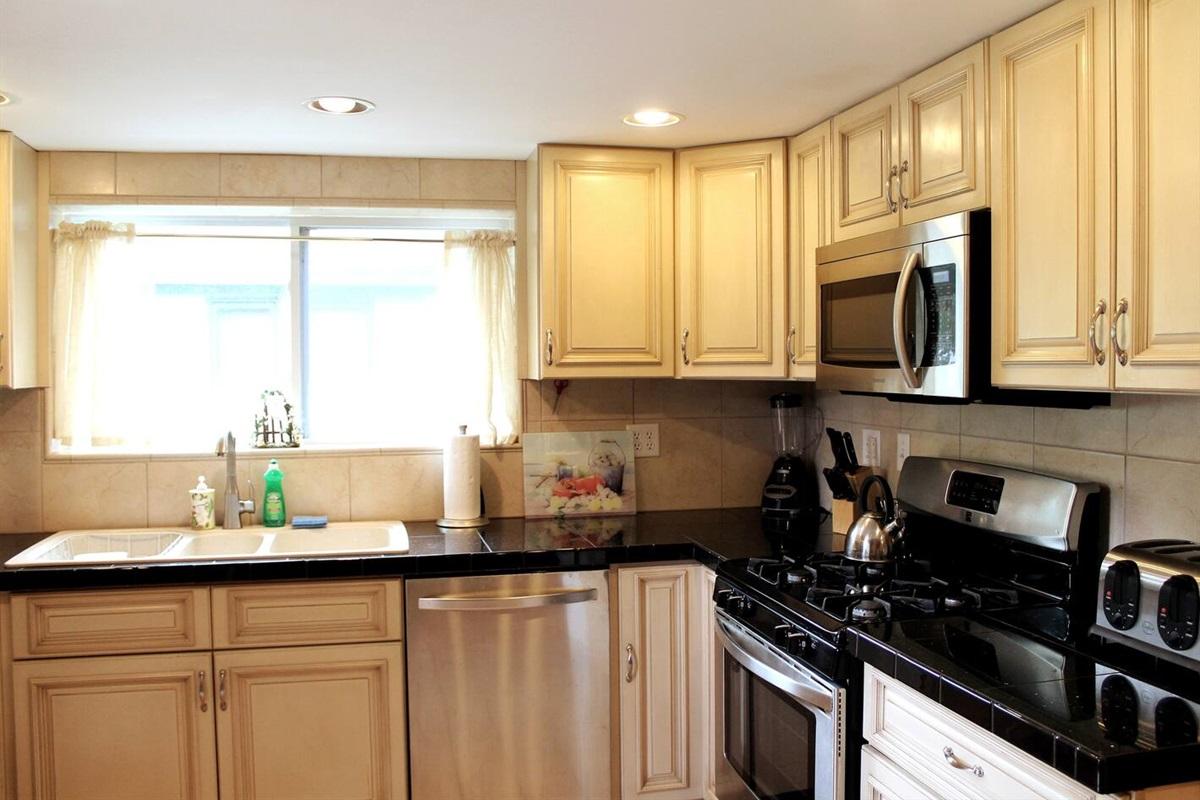 Bright, airy kitchen with granite countertops