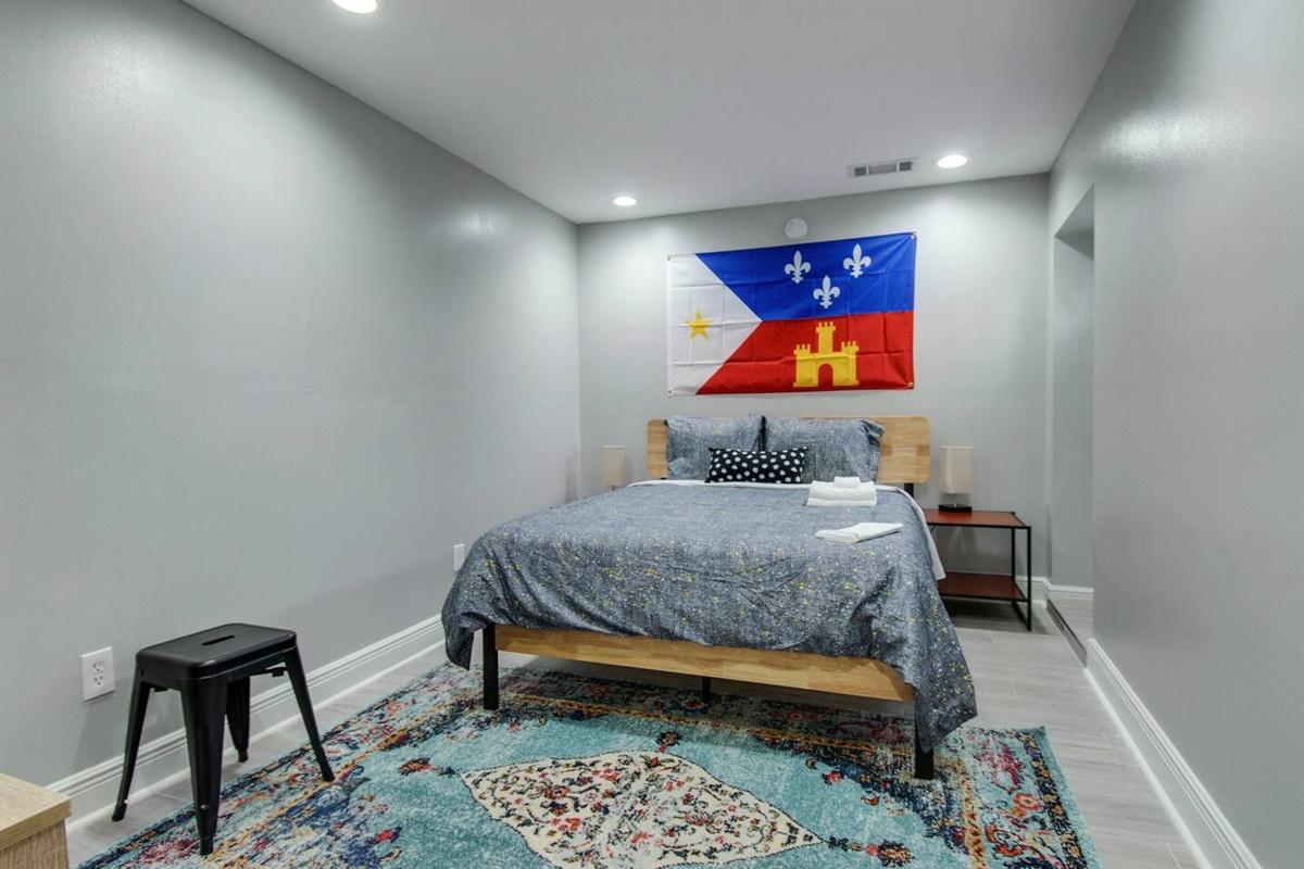Bedroom 3. Queen bed.  Exterior door.