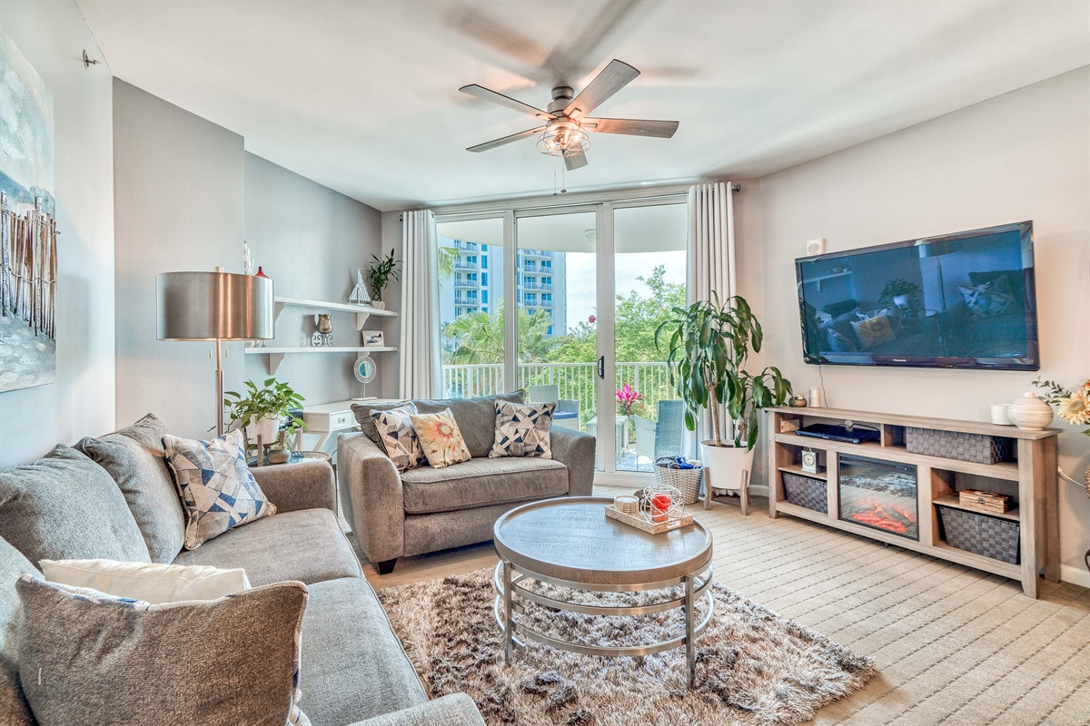 Spacious living area w/sleeper sofa, electric fireplace, large Smart TV & More