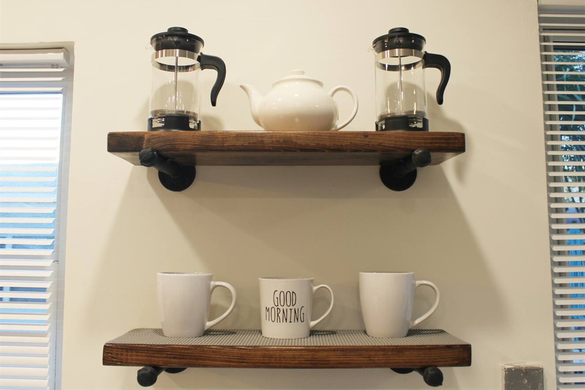Tea pot and 2 french presses at the coffee bar.