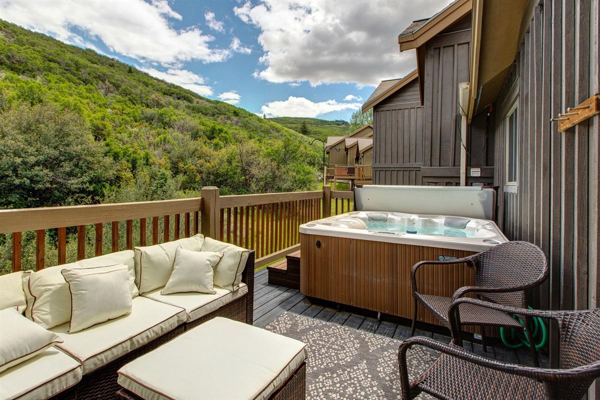 Back deck - Hot tub, sitting area, BBQ