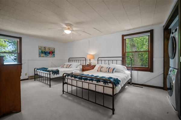 The guest bedroom features two queen beds and great light.