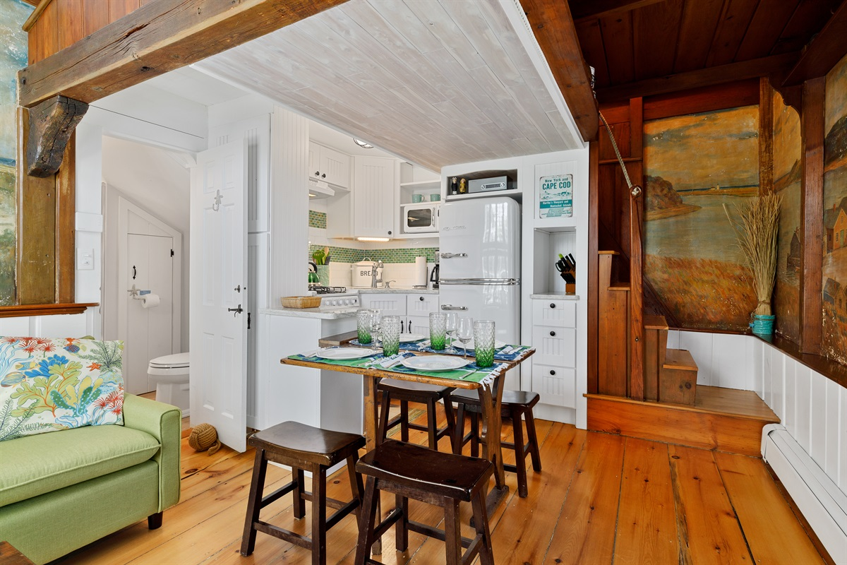 Small but fully equipped galley style kitchenette sits to the rear of the cottage in a combined living and dining area.