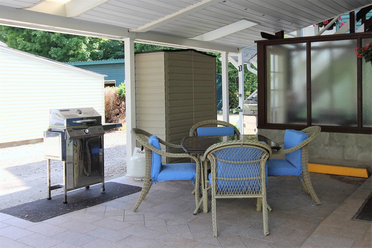Covered patio with gas grill for relaxing after a long day at the ball field.