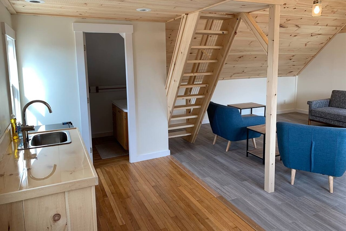 Kitchenette, bathroom, and stairs to sleeping loft