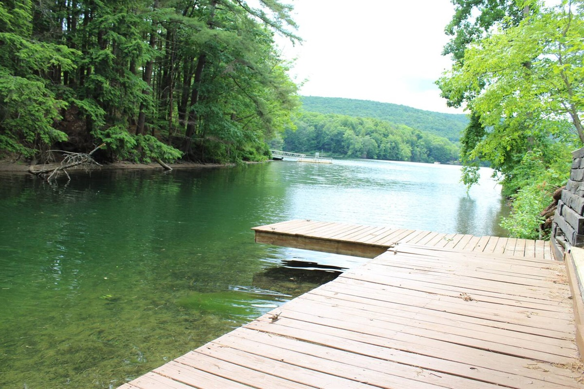 A secluded private dock area between the open lake and a small cove area