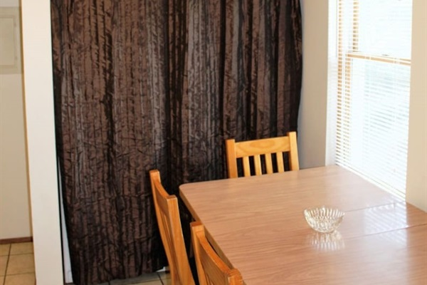 Dining area with enclosed on-site laundry