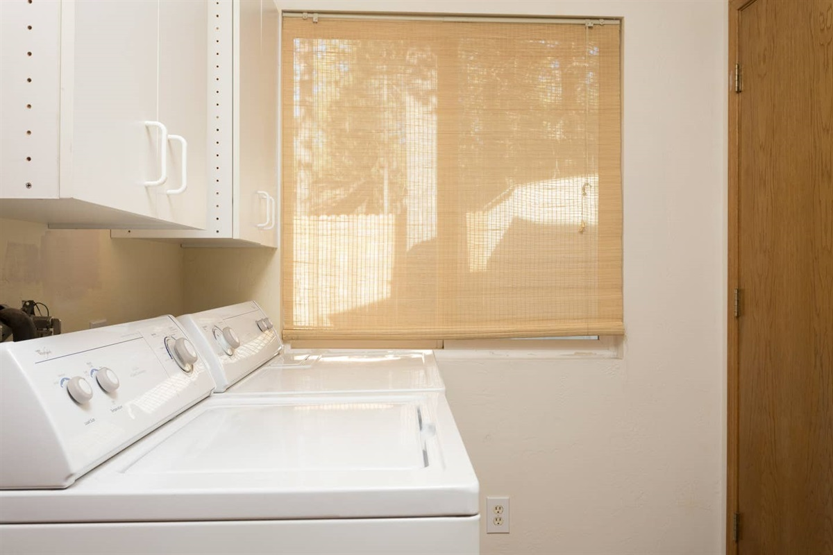 Laundry room next to the master bedroom (Bedroom #1) with entrance to backyard and full size washer & dryer.