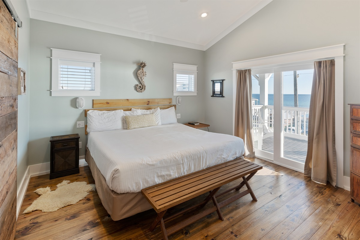 "Also known as the Seahorse suite, this room has a vaulted ceiling, commanding views of the Gulf, and a spa-like private bath with a custom-built reclaimed barnwood door. This room is generally claimed by the ""Host"" of the group!"