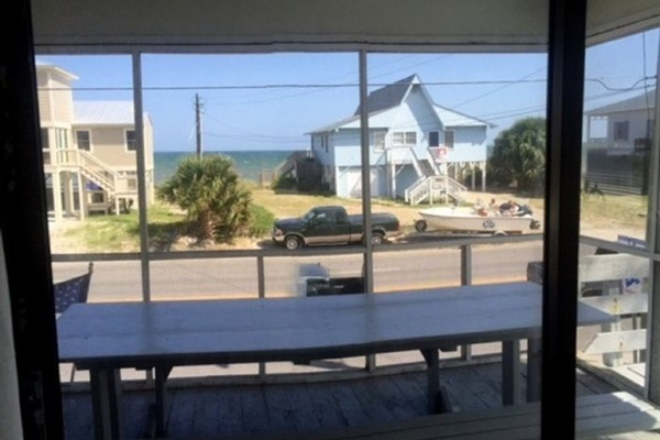 VIew from inside Living area looking out to the beach across the street!