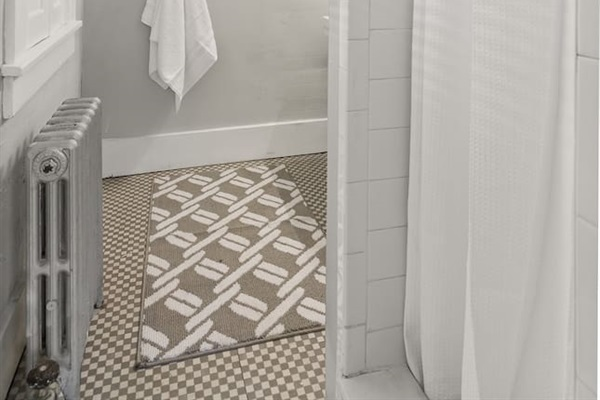 Bathroom stocked with fresh towels, shampoo, conditioner, and body wash for your stay!