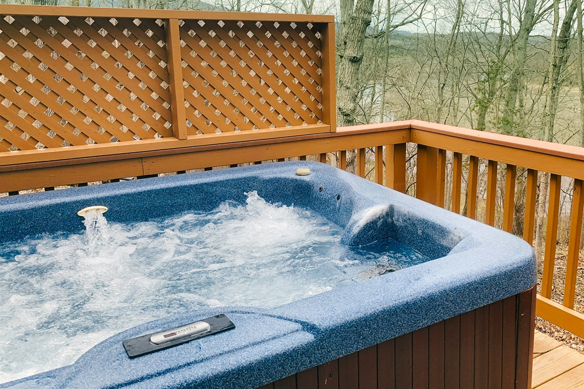 Large modern hot tub for 4 guests with view of nearby river and mountains
