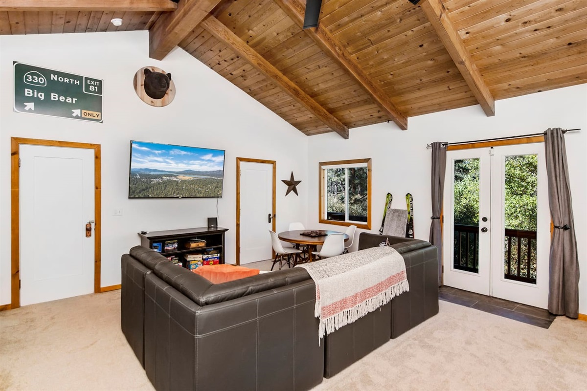 """Bedroom #1 (Lower Level): All three bedrooms feature a big 65"""" Roku smart TV with Netflix, Apple TV, and Hulu."""