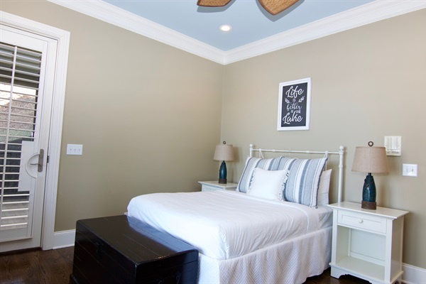 2nd floor bedroom with full bed overlooks the lake